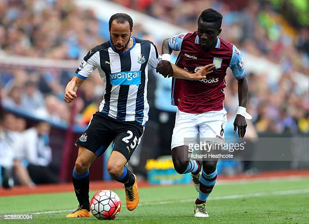Andros Townsend of Newcastle United and Idrissa Gueye of Aston Villa compete for the ball during the Barclays Premier League match between Aston...