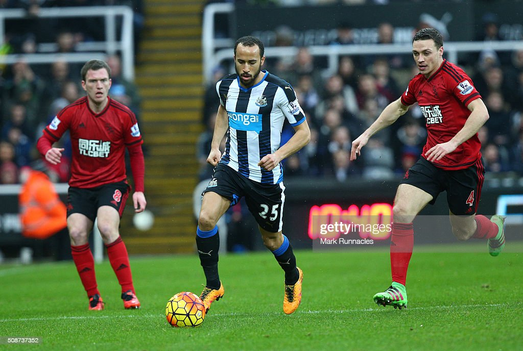 <a gi-track='captionPersonalityLinkClicked' href=/galleries/search?phrase=Andros+Townsend&family=editorial&specificpeople=4266573 ng-click='$event.stopPropagation()'>Andros Townsend</a> of Newcastle United is tracked by <a gi-track='captionPersonalityLinkClicked' href=/galleries/search?phrase=James+Chester&family=editorial&specificpeople=4192570 ng-click='$event.stopPropagation()'>James Chester</a> and <a gi-track='captionPersonalityLinkClicked' href=/galleries/search?phrase=Craig+Gardner&family=editorial&specificpeople=685283 ng-click='$event.stopPropagation()'>Craig Gardner</a> of West Bromwich Albion during the Barclays Premier League match between Newcastle United FC and West Bromwich Albion FC at St James' Park on February 6, 2016 in Newcastle Upon Tyne, England.