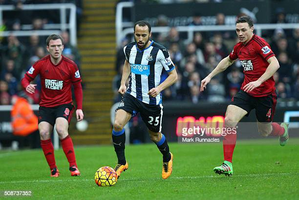 Andros Townsend of Newcastle United is tracked by James Chester and Craig Gardner of West Bromwich Albion during the Barclays Premier League match...