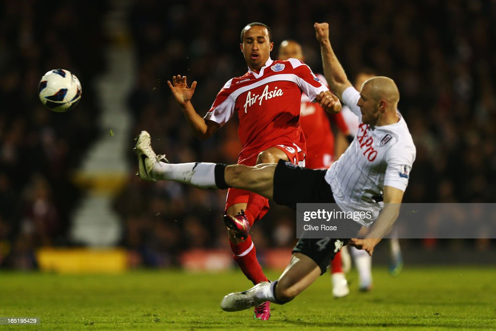 Andros Townsend (L) of Queens Park Rangers is challenged by <a gi-track='captionPersonalityLinkClicked' href=/galleries/search?phrase=Philippe+Senderos&family=editorial&specificpeople=221471 ng-click='$event.stopPropagation()'>Philippe Senderos</a> (R) of Fulham during the Barclays Premier League match between Fulham and Queens Park Rangers at Craven Cottage on April 1, 2013 in London, England.