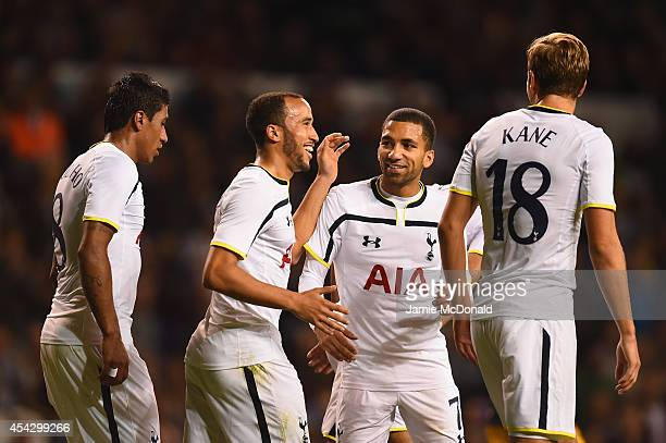 Andros Townsend of Spurs celebrates scoring theiur third goal from the penalty spot with Aaron Lennon Paulinho and Harry Kane of Spurs during the...