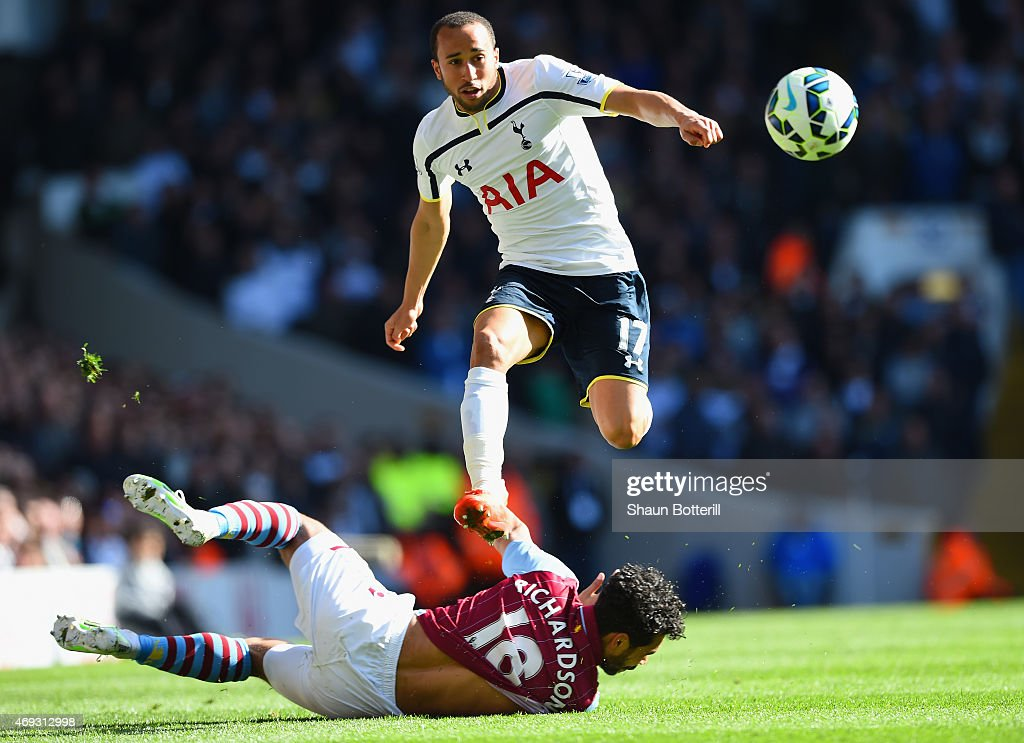 <a gi-track='captionPersonalityLinkClicked' href=/galleries/search?phrase=Andros+Townsend&family=editorial&specificpeople=4266573 ng-click='$event.stopPropagation()'>Andros Townsend</a> of Spurs evades a challenge from <a gi-track='captionPersonalityLinkClicked' href=/galleries/search?phrase=Kieran+Richardson+-+Soccer+Player&family=editorial&specificpeople=208833 ng-click='$event.stopPropagation()'>Kieran Richardson</a> of Aston Villa during the Barclays Premier League match between Tottenham Hotspur and Aston Villa at White Hart Lane on April 11, 2015 in London, England.