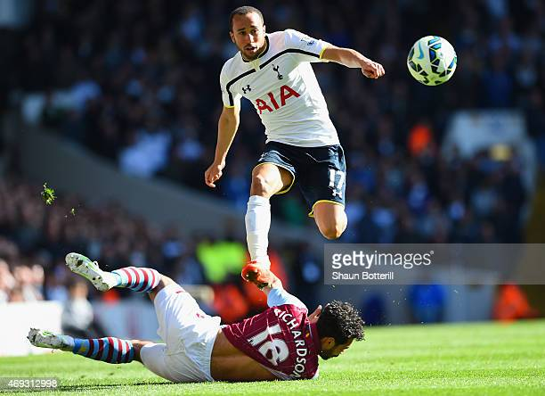 Andros Townsend of Spurs evades a challenge from Kieran Richardson of Aston Villa during the Barclays Premier League match between Tottenham Hotspur...