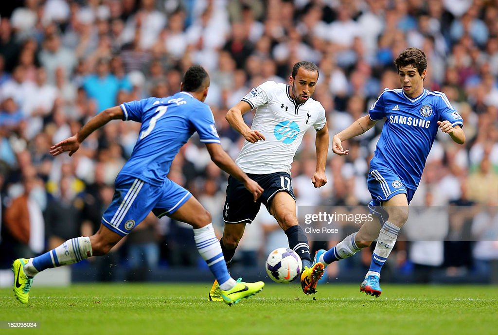 Andros Townsend of Tottenham Hotspur goes between Ashley Cole (L) and Oscar of Chelsea (R) during the Barclays Premier League match between Tottenham Hotspur and Chelsea at White Hart Lane on September 28, 2013 in London, England.