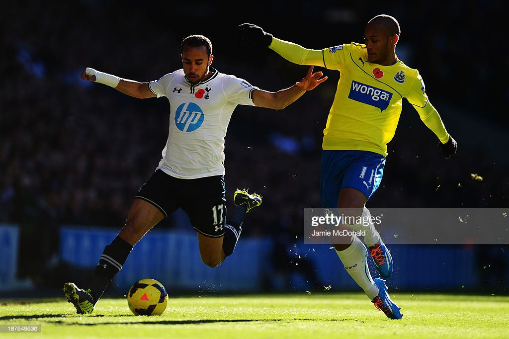 <a gi-track='captionPersonalityLinkClicked' href=/galleries/search?phrase=Andros+Townsend&family=editorial&specificpeople=4266573 ng-click='$event.stopPropagation()'>Andros Townsend</a> of Tottenham Hotspur holds off the challenge of <a gi-track='captionPersonalityLinkClicked' href=/galleries/search?phrase=Yoan+Gouffran&family=editorial&specificpeople=534470 ng-click='$event.stopPropagation()'>Yoan Gouffran</a> of Newcastle United during the Barclays Premier League match between Tottenham Hotspur and Newcastle United at White Hart Lane on November 10, 2013 in London, England.