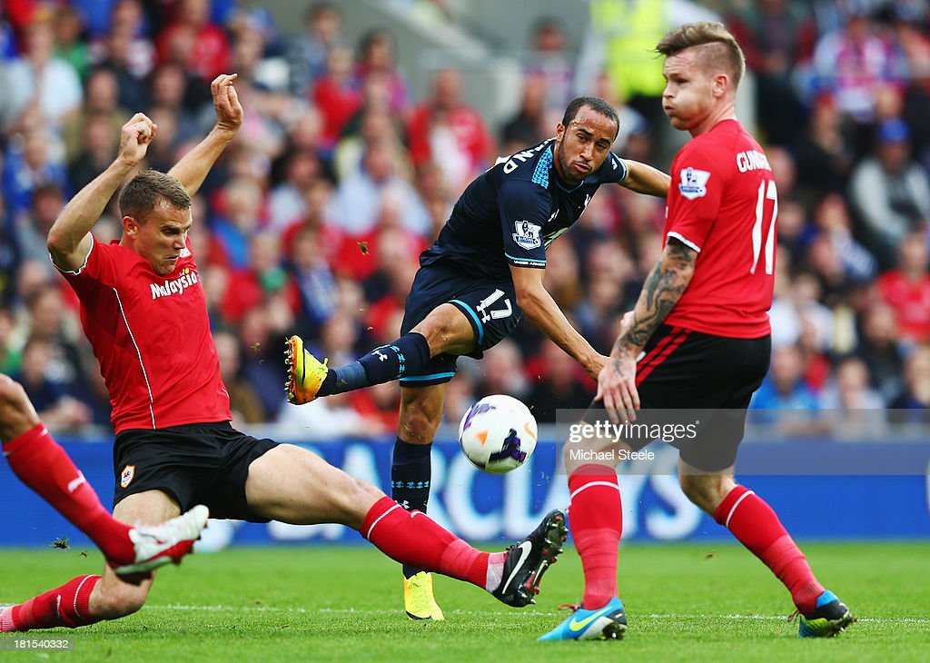 Andros Townsend of Tottenham Hotspur is blocked by Ben Turner (L) and Aron Gunnarsson of Cardiff City (R) during the Barclays Premier League match between Cardiff City and Tottenham Hotspur at Cardiff City Stadium on September 22, 2013 in Cardiff, Wales.