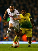 Andros Townsend of Tottenham Hotspur is tackled by Jucilei of Anzhi Makhachkala during the UEFA Europa League Group K match between Tottenham Hotspur...