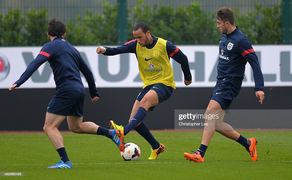 Andros Townsend takes on Leighton Baines and Jay Rodriguez during England Training at London Colney on November 18, 2013 in St Albans, England.