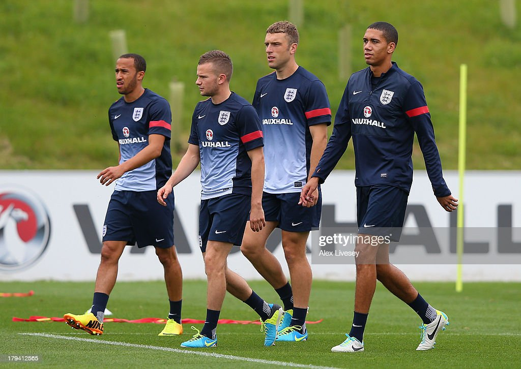 <a gi-track='captionPersonalityLinkClicked' href=/galleries/search?phrase=Andros+Townsend&family=editorial&specificpeople=4266573 ng-click='$event.stopPropagation()'>Andros Townsend</a>, <a gi-track='captionPersonalityLinkClicked' href=/galleries/search?phrase=Tom+Cleverley+-+Soccer+Player&family=editorial&specificpeople=4192565 ng-click='$event.stopPropagation()'>Tom Cleverley</a>, <a gi-track='captionPersonalityLinkClicked' href=/galleries/search?phrase=Rickie+Lambert&family=editorial&specificpeople=4124959 ng-click='$event.stopPropagation()'>Rickie Lambert</a> and <a gi-track='captionPersonalityLinkClicked' href=/galleries/search?phrase=Chris+Smalling&family=editorial&specificpeople=5964313 ng-click='$event.stopPropagation()'>Chris Smalling</a> of England during a training session at St Georges Park on September 3, 2013 in Burton-upon-Trent, England.