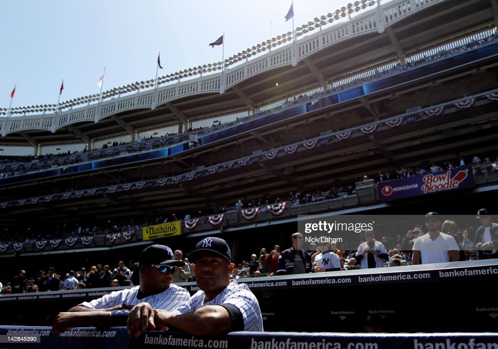 Andruw Jones (L) #22 and <a gi-track='captionPersonalityLinkClicked' href=/galleries/search?phrase=Mariano+Rivera&family=editorial&specificpeople=201607 ng-click='$event.stopPropagation()'>Mariano Rivera</a> #42 of the New York Yankees looks on from the dugout prior to their game against the Los Angeles Angels during the home opener at Yankee Stadium on April 13, 2012 in the Bronx borough of New York City.