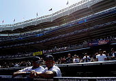Andruw Jones and Mariano Rivera of the New York Yankees looks on from the dugout prior to their game against the Los Angeles Angels during the home...