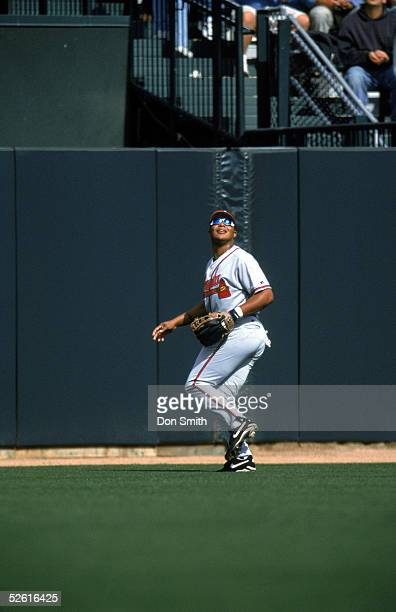 Andruw Jones of the Atlanta Braves fields a fly ball during a 2002 season game at Pac Bell Park in San Francisco California