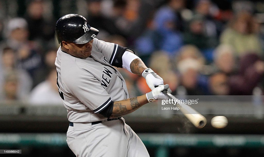 <a gi-track='captionPersonalityLinkClicked' href=/galleries/search?phrase=Andruw+Jones+-+Baseball+Player&family=editorial&specificpeople=203331 ng-click='$event.stopPropagation()'>Andruw Jones</a> #22 of the New York Yankees doubles to left field in the eighth inning scoring <a gi-track='captionPersonalityLinkClicked' href=/galleries/search?phrase=Nick+Swisher&family=editorial&specificpeople=206417 ng-click='$event.stopPropagation()'>Nick Swisher</a> #33 during the game against the Detroit Tigers at Comerica Park on June 1, 2012 in Detroit, Michigan. The Yankees defeated the Tigers 9-4.