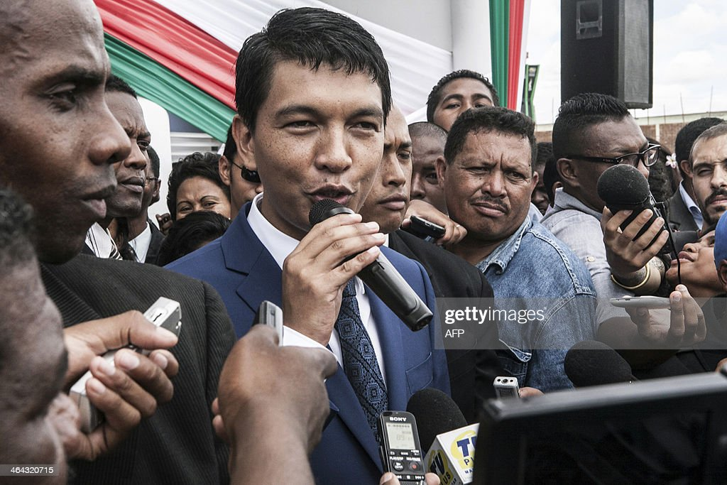 <a gi-track='captionPersonalityLinkClicked' href=/galleries/search?phrase=Andry+Rajoelina&family=editorial&specificpeople=4758126 ng-click='$event.stopPropagation()'>Andry Rajoelina</a> (C), the transitional President of Madagascar, speaks about his political future as he addresses journalists during the inauguraiton of a hospital in Antananarivo on January 22, 2014. Hery Rajaonarimapianina, who was Finance Minister in Rajoelina's unelected transitional government, will be sworn in as Madagascar's newly elected president at the weekend.