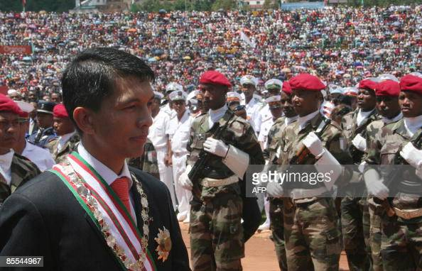 Andry Rajoelina walks past a guard of honour during a ceremony in Antananarivo's stadium where he was officially invested as transitional president...