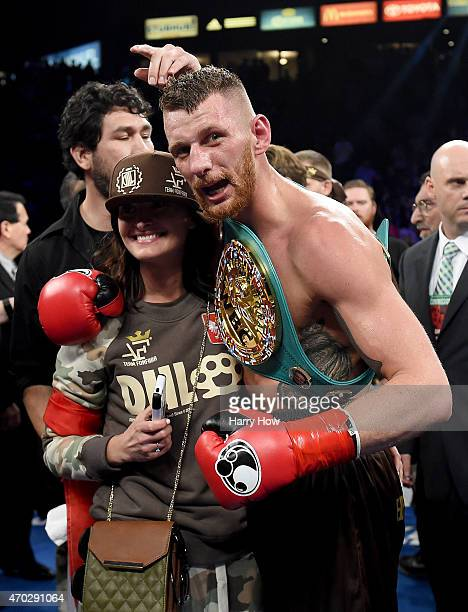 Andrzej Fonfara poses with his belt and wife after his TKO over Julio Cesar Chavez Jr during the ninth round to win the WBC light heavyweight title...