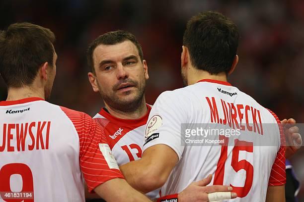 Andrzej Rojewski Bartosz Jurecki and Michal Jurecki of Poland celebrate after the IHF Men's Handball World Championship group D match between Poland...