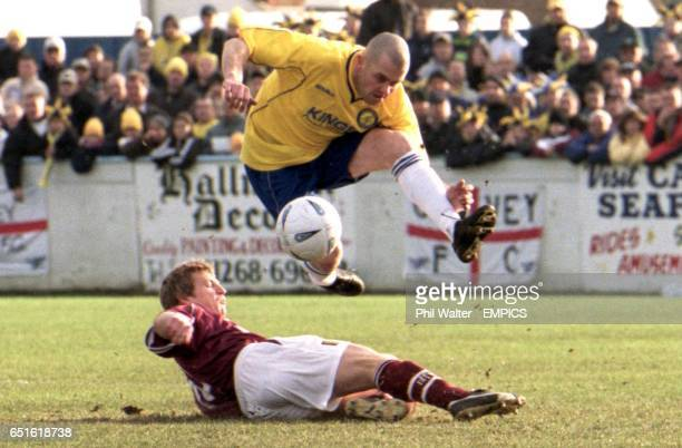 and's Julian Dicks leaps over Northampton Town's Marco Gabbiadini