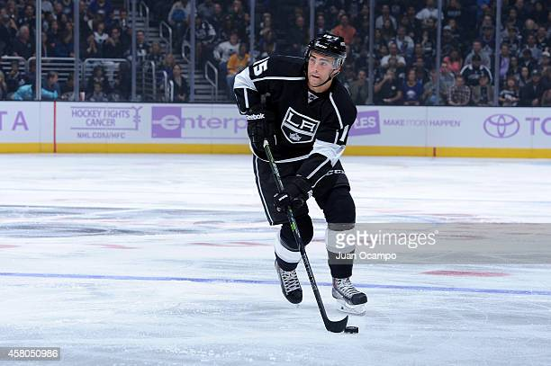 Andy Andreoff of the Los Angeles Kings handles the puck during a game against the Buffalo Sabres at STAPLES Center on October 23 2014 in Los Angeles...