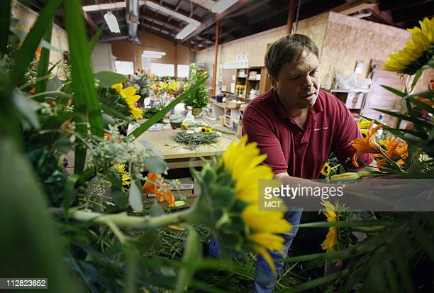Andy Azzaro operations manager of San Francisco Floral in Fresno California puts together a flower arrangement for a funeral at the flower shop...