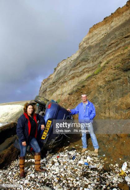Andy Baldwin surveys the wreckage of his father's Vauxhall Corsa with his partner Julia Woods after his father accidentally drove it over the edge of...