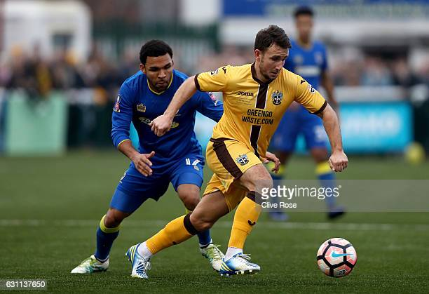 Andy Barcham of AFC Wimbledon closes down Matt Tubbs of Sutton United during The Emirates FA Cup Third Round match between Sutton United and AFC...