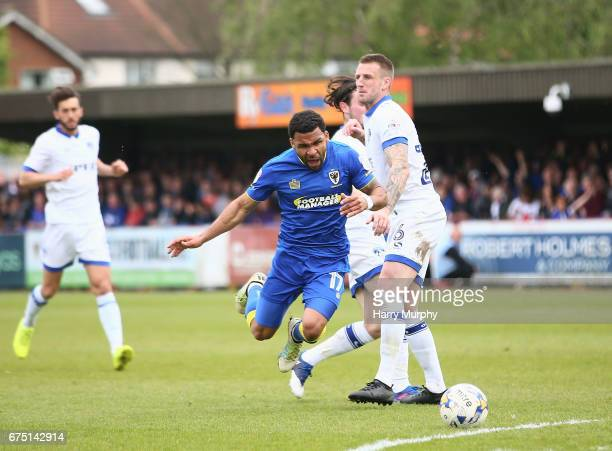 Andy Barcham of AFC Wimbledon is challenged by Peter Clarke of Oldham Athletic during the Sky Bet League One match between AFC Wimbledon and Oldham...