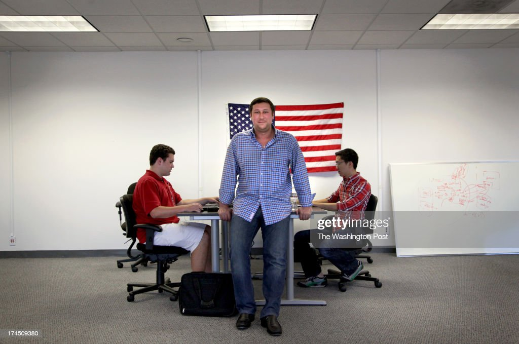 Andy Barkett, a former Facebook software engineer, is the new technology officer for the Republican National Committee. He poses for a portrait at his new offices in San Mateo, Calif., on Thursday, July 25, 2013. With him are software engineers Henry Pfirrmann (left) and Newton Der (right).