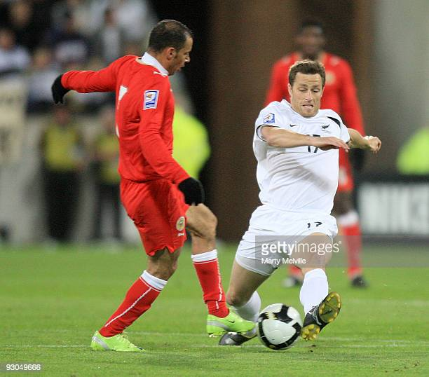 Andy Barron of the All Whites gets tackled by Sayed Mahmood Jala of Bahrain during the 2010 FIFA World Cup Asian Qualifier match between New Zealand...