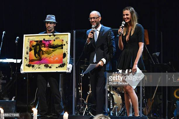 Andy Boose and Alina Baikova speak onstage at the Unitas gala against Sex Trafficking at Capitale on September 15 2015 in New York City