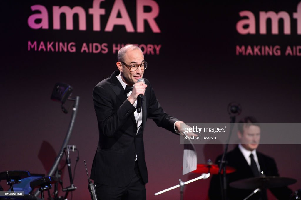Andy Boose speaks onstage at the amfAR New York Gala to kick off Fall 2013 Fashion Week at Cipriani Wall Street on February 6, 2013 in New York City.