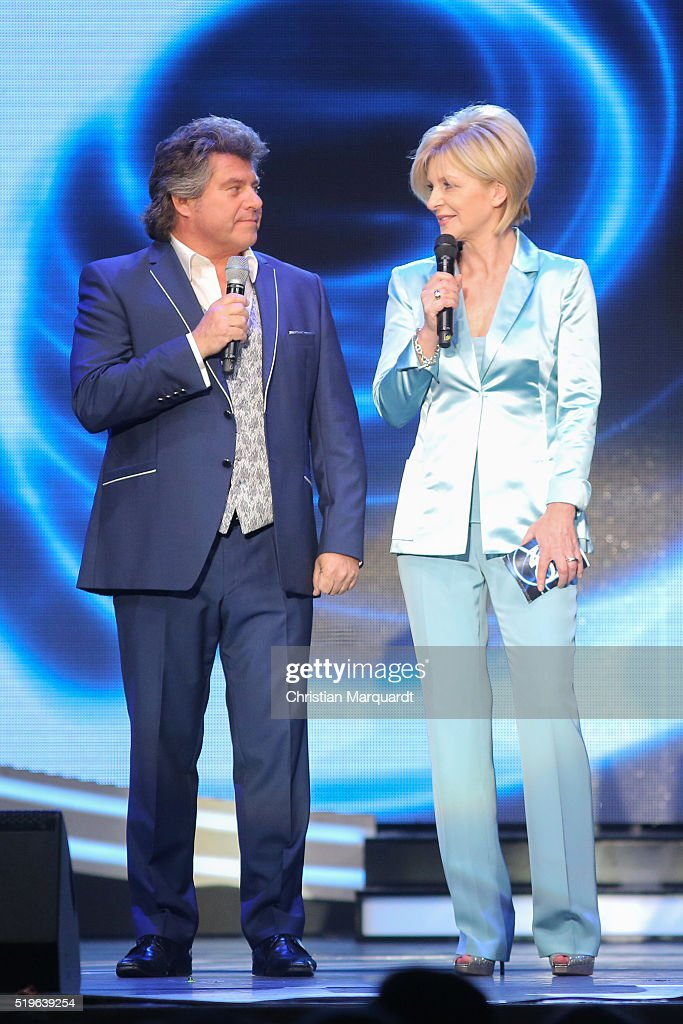 Andy Borg and Carmen Nebel perform on stage during the tv show 'Willkommen bei Carmen Nebel' at Tempodrom on April 7 2016 in Berlin Germany