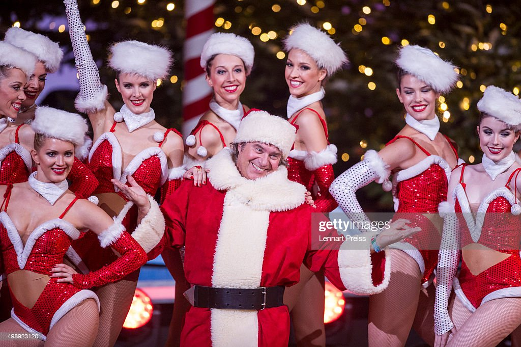Andy Borg as Santa Borg and members of the Deutsches Fernsehballett perform during the 'Heiligabend mit Carmen Nebel' TV show at Bavaria Filmstudios...
