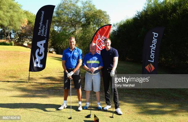 Andy Bowden of Coca Cola Mark Treacey of Lombard and Ross Parker of PGA pose for a group shot shot on the 1st tee during The Lombard Trophy Final Day...