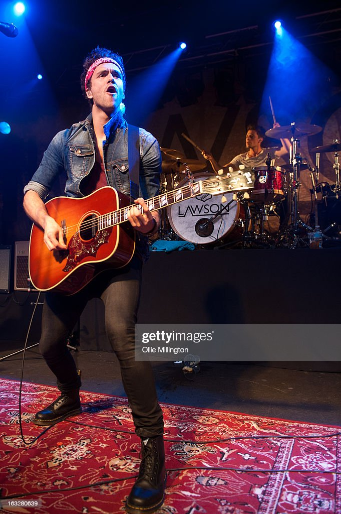 Andy Brown and <a gi-track='captionPersonalityLinkClicked' href=/galleries/search?phrase=Adam+Pitts&family=editorial&specificpeople=7078662 ng-click='$event.stopPropagation()'>Adam Pitts</a> of Lawson perform during a sold out show on their Chapman Square Tour at Rock City on March 6, 2013 in Nottingham, England.