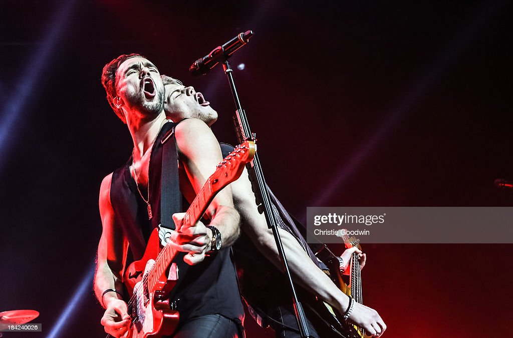 Andy Brown and Ryan Fletcher of Lawson perform on stage at The Roundhouse on October 12, 2013 in London, England.