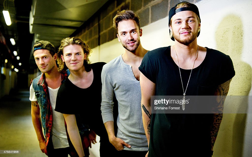 Andy Brown Ryan Fletcher Joel Peat and Adam Pitts of Lawson pose backstage after performing and signing copies of their album 'Roads' at HMV...
