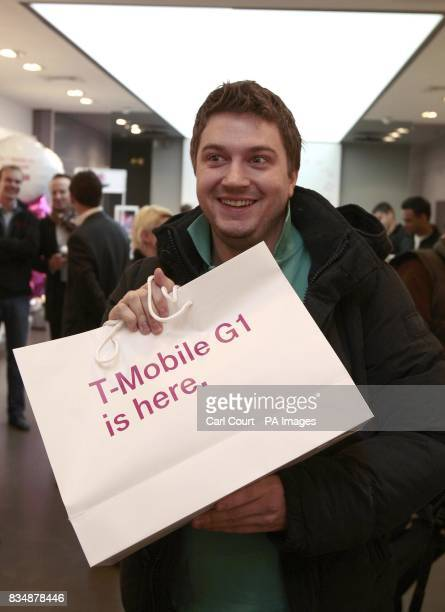 Andy Burgess a software developer from London becomes the first person in the UK to buy a TMobile G1 mobile phone after it went on sale for the first...