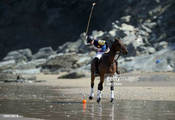 Andy Burgess rides his horse at Watergate Bay as he practices for the beach polo competition being held on the beach this weekend on May 17 2013 in...