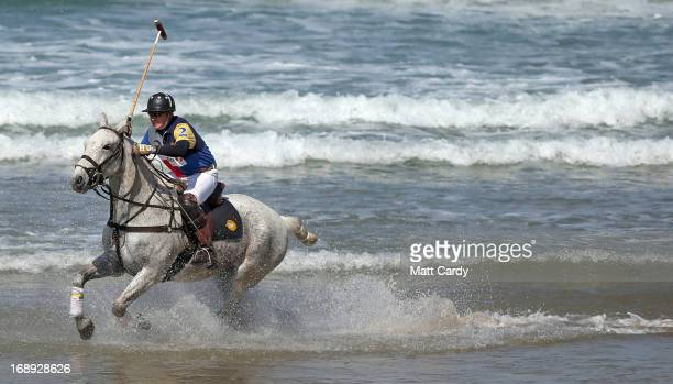 Andy Burgess rides his horse Shrivar into the sea at Watergate Bay as he practices for the beach polo competition being held on the beach this...