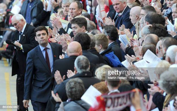 MP Andy Burnham takes his seat after his speech as Trevor Hicks makes his way to the microphone during the Hillsborough 25th Anniversary Memorial...