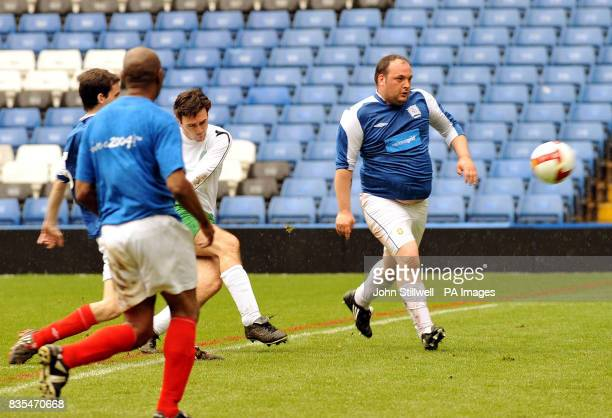 Andy Burnham the Secretary of State for Culture Media Sport fires in his third goal for the UK Parliamentary Football team against a sporting...