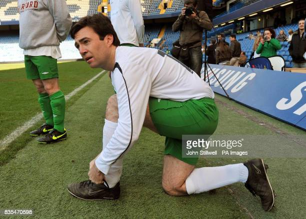 Andy Burnham the Secretary of State for Culture Media Sport MP laces up his boots before coming on as a substitute for the UK Parliamentary Football...