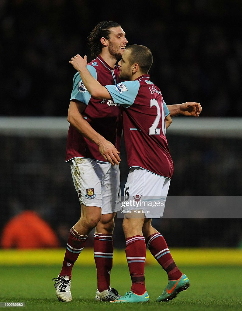 Andy Carroll and Joe Cole of West Ham United embrace after the Barclays Premier League match between West Ham United and Swansea at the Boleyn Ground on February 2, 2013 in London, England.