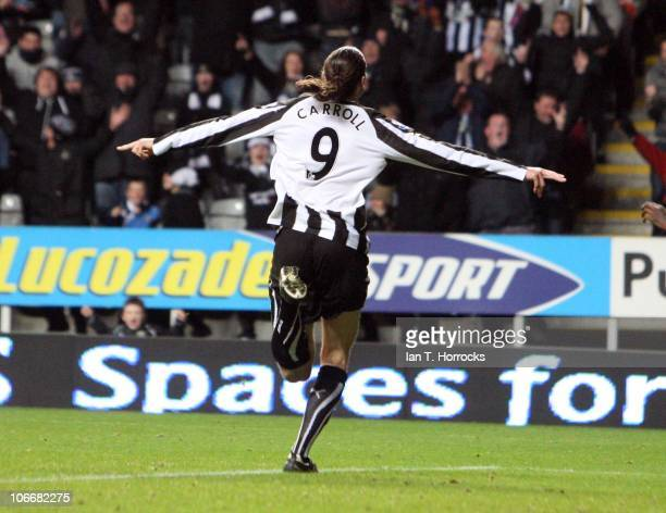 Andy Carroll celebrates after scoring the second goal and equalizing for Newcastle during the Barclays Premier League match between Newcastle United...