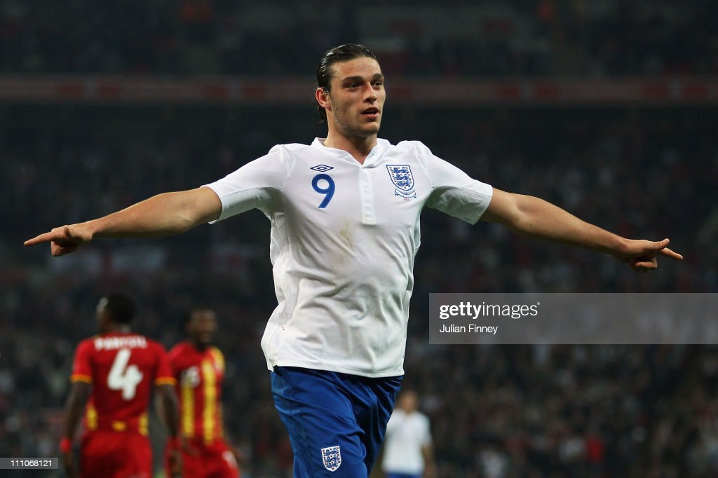 <a gi-track='captionPersonalityLinkClicked' href=/galleries/search?phrase=Andy+Carroll+-+Soccer+Player&family=editorial&specificpeople=1449090 ng-click='$event.stopPropagation()'>Andy Carroll</a> of England celebrates as he scores their first goal during the international friendly match between England and Ghana at Wembley Stadium on March 29, 2011 in London, England.
