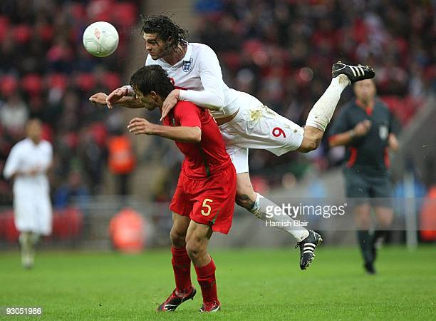 9 Andy Carroll of England wins a header against Miguel Vitor of Portugal during the UEFA Under21 Championship Group 9 Qualifying match between...