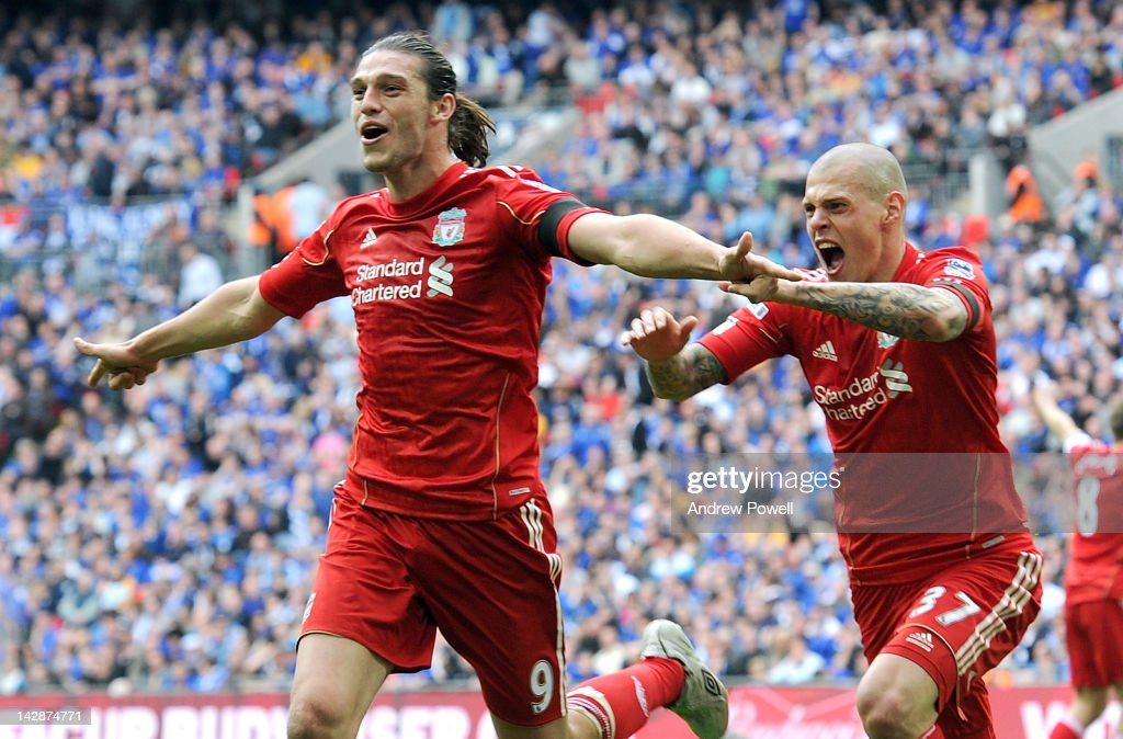 Andy Carroll of Liverpool celebrates his goal with Martin Skrtel of Liverpool during the FA Cup semi-final sponsored by Budweiser between Liverpool and Everton at Wembley Stadium on April 14, 2012 in London, England.
