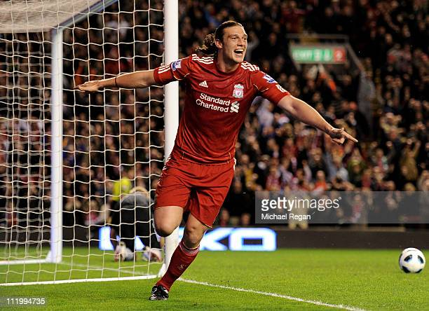 Andy Carroll of Liverpool celebrates scoring his team's third goal during the Barclays Premier League match between Liverpool and Manchester City at...