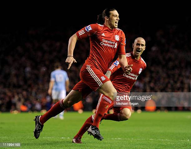 Andy Carroll of Liverpool celebrates scoring the opening goal with team mate Raul Meireles during the Barclays Premier League match between Liverpool...